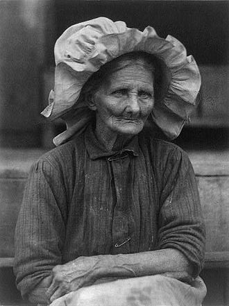 Bonnet (headgear) - Old woman in sunbonnet (c. 1930). Photograph by Doris Ulmann