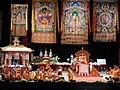 On the stage, HH the Dalai Lama, HH The Karmapa (wearing red deity hat signifying red secret bodhicitta), thangkas, Kalachakra pavilion, monks, nun, formal robes, Kalachakra for World Peace, Washington D.C., USA.jpg