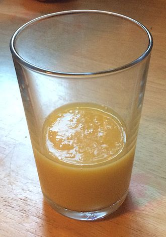 Orange juice - A glass of orange juice with pulp