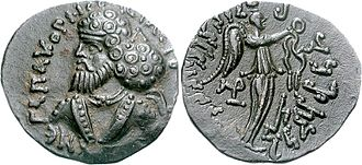 Pacores - Coin of Pakores. Obv Bust of king with Greek legend  BACILEYC (BACILEwN) NEGA PAKOPHC. Rev Nike standing right, holding a victory wreath. Kharoshthi legend.