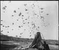 Paratroopers of the 187th RCT (Regimental Combat Team) float earthward from C-119's to cut off retreating enemy units... - NARA - 531401.tif