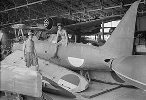 No. 80 Squadron RAF - Personnel of 80 Squadron RAF amongst parts of a Mitsubishi F1M, bearing Indonesian markings, at an airfield and seaplane base in Surabaya, Java, January 1946. In the background are Kawanishi N1K floatplanes