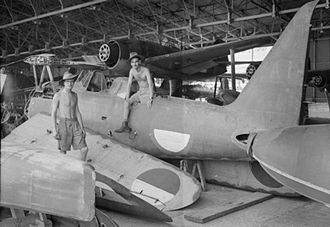 Mitsubishi F1M - Personnel of 80 Squadron RAF amongst parts of a Japanese F1M, bearing Indonesian markings, at an airfield and seaplane base in Surabaya, Java. January 1946