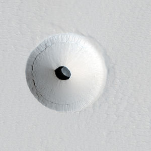 Caves of Mars Project - A HiRISE image of a lava tube skylight entrance on the Martian volcano Pavonis Mons.