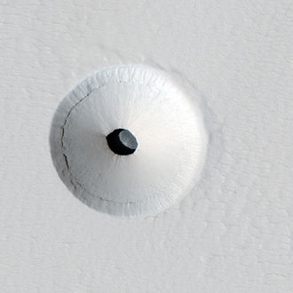 Martian lava tube - Cropped version of a HiRISE image of a lava tube skylight entrance on the Martian volcano Pavonis Mons.