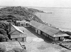 Fort Pearce - Pearce Barracks in 1946, with Fort Nepean in the background. (Australian War Memorial)
