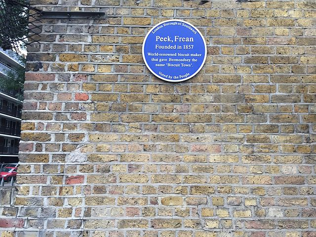 Peek, Frean, George Hender Frean, and James Peek blue plaque - Peek, Frean   Founded in 1857    World renowned biscuit maker that gave    Bermondsey the name 'Biscuit Town'