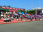 People Sitting on Ground Stairs before Event Opening 20131012.jpg