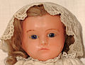 Pierotti wax doll from Frederic Aldis, London, 03, sitting doll, vested, face.jpg