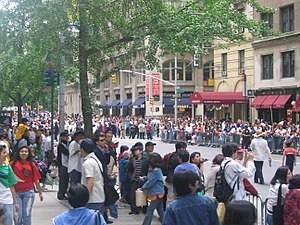 Demographics of New York City - Spectators at the Philippine Independence Day Parade on Madison Avenue in Midtown Manhattan.