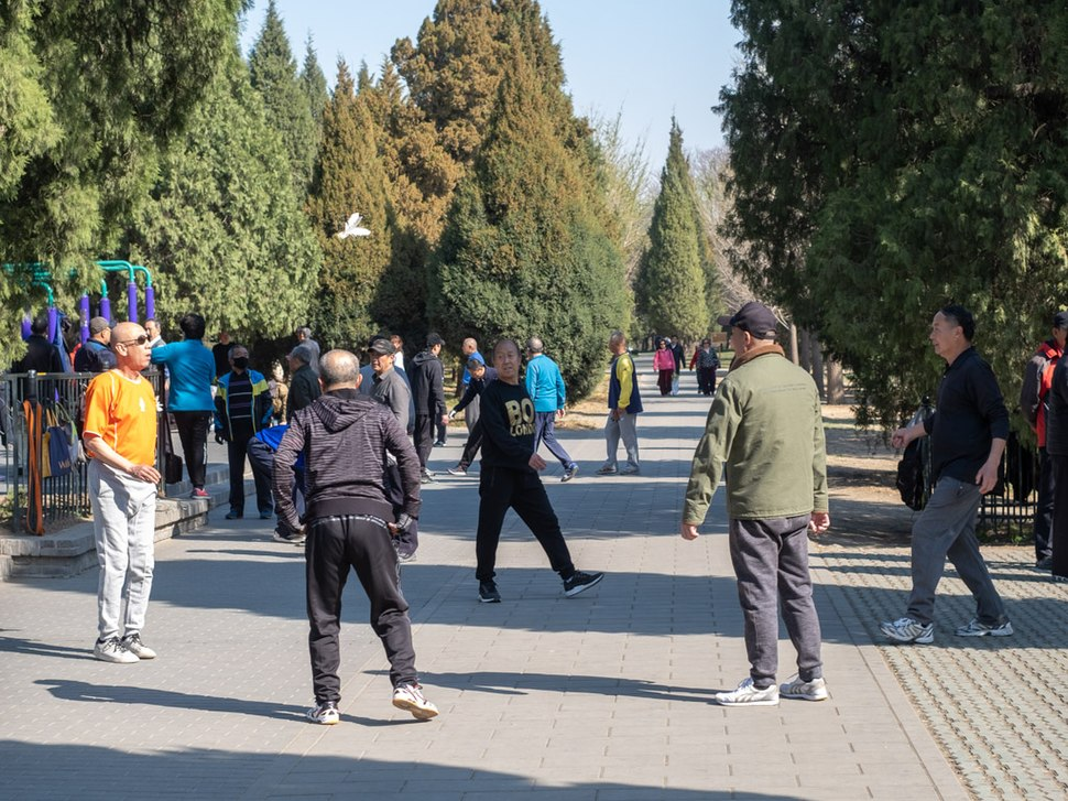 Playing Jianzi in the Temple of Heaven Park in Beijing