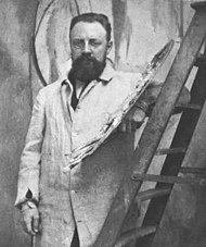 Portrait of Henri Matisse standing at his easel (cropped).jpg