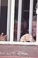 President Bill Clinton and President Nelson Mandela view Cell Block B where President Mandela was imprisoned.jpg