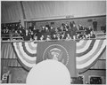 President Truman waves to the crowd from the bleachers at the inaugural gala at the National Guard Armory in... - NARA - 199988.tif