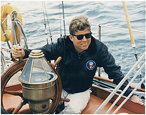 """President Vacations in Maine. At the wheel of the US Coast Guard Yacht """"Manitou"""". Boothbay Harbor, ME. - NARA - 194210"""