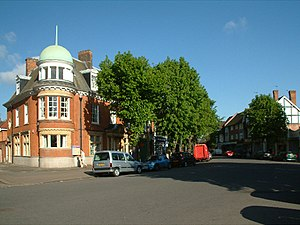 Bush Hill Park - Queen Anne's Parade. In the background is the former bank now the home to a nursery school