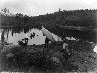 Guide - Adirondack guides (carrying and rowing guideboats on the Raquette River, 1888