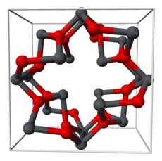 Alternating dark gray and red balls connected by dark gray-red cylinders