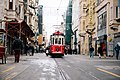 Red cable car in city (Unsplash).jpg