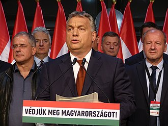 """2016 Hungarian migrant quota referendum - Viktor Orbán declares the government's victory after the publication of the preliminary result on the eve of the referendum. Subtitle: """"Let us defend Hungary!"""""""