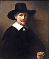 Rembrandt - Portrait of a Man Holding Gloves.JPG