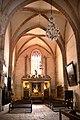 Retable majeur dans le transept sud de l'église abbatiale Saint-Pierre de Marcilhac-sur-Célé.jpg