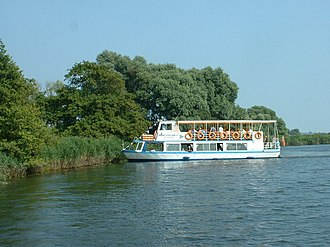 Burgh St Peter - A river cruiser turning on the River Waveney at Seven Mile Carr, in Burgh St Peter parish southeast of the village