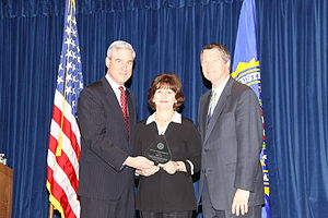 Mike Gottfried - FBI Director Robert Mueller (left) recognizes Mickey and Mike Gottfried (right) with a 2010 Director's Community Leadership Award for their work with Team Focus youth camps.