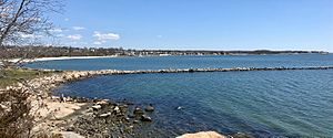 East Lyme, Connecticut - View of the Rocky Neck State Park jetty, beach and the Giants Neck area shoreline in the Niantic section of East Lyme, Connecticut.