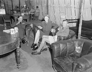 Air Marshal Sir Arthur Tedder (left), Lady Tedder, and Air Vice-Marshal R. M. Foster, Air Officer Commanding the Desert Air Force, in the Officers' Mess of No. 8 Wing SAAF at Campoformido, Udine, Italy.