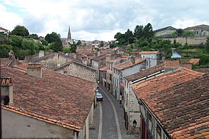 Parthenay - The Rue de la Vau Saint-Jaques from the upper chamber of the Saint-Jacques Gate, with the town centre on the skyline ahead, and the east side of the citadel to the right