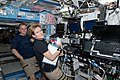 STS-130 Hire and Creamer at Canadarm workstation.jpg