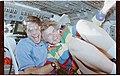 STS058-25-004 - STS-058 - Candid views of two crewmembers in the forward flight deck. - DPLA - 550f3b30ea3214d08b241d344fc67081.jpg
