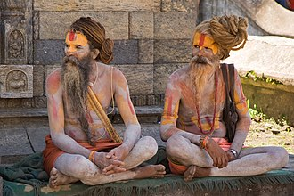 Moksha - Two Hindu sadhus near Pashupatinath Temple in Kathmandu, Nepal. Usually sadhus live by themselves, and spend their days in their pursuit of moksha.