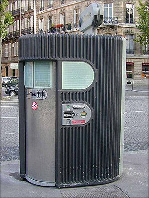 Automatic self-clean toilet seat - A Sanisette (self-cleaning street toilet) in Paris, France. July 1999