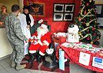 Santa Claus greets Airmen, families at post office 121217-F-HA826-245.jpg