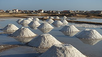 Santa Maria salt ponds - Piles of salt on an evaporation pond north of town