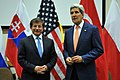 Secretary Kerry Addresses Reporters Before Meeting With Turkish Foreign Minister Davutoglu in Brussels (14318611758).jpg