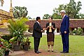 Secretary Kerry Listens to His Tour Guides During Visit to That Luang Stupa in Laos (23970994173).jpg