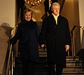 Secretary of State-nominee Hillary Rodham Clinton and husband, former President Bill Clinton descend the stairs at the U.S. Capitol for the start of the 56th Presidential Inauguration in Washington, D.C 090120-F-MN103-371 (cropped).jpg