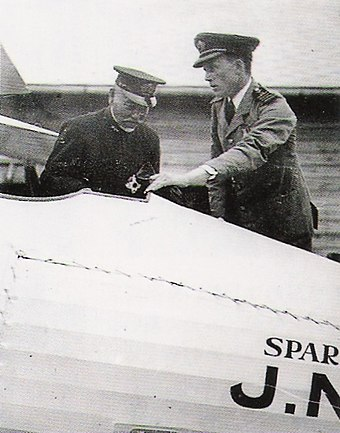 Captain Sempill showing a Sparrowhawk to Gensui Count Togo Heihachiro (as he was at the time) in 1921. SempillMission.jpg