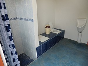 Shower, double-vault urine-diverting dry toilet (UDDT) and waterless urinal in Lima, Peru.jpg
