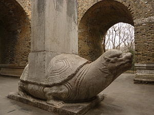 "Ancestor veneration in China - A stone tortoise with the ""Stele of Divine Merits and Saintly Virtues"" (Shengong Shende), erected by the Yongle Emperor in 1413 in honor of his father, the Hongwu Emperor in the Ming Xiaoling Mausoleum (""Ming Mausoleum of Filial Piety"")."