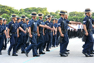 Gurkha Contingent - The Gurkha Contingent marches past at the Police Day Parade 2005 held for the last time at the Police academy grounds in Thomson Road. The officers are dressed in the old no. 3 dress and carry the M16 rifle