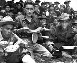 Campamento Santiago - Soldiers of the 65th Infantry chow during a day of training in Salinas, Puerto Rico. August 1941.