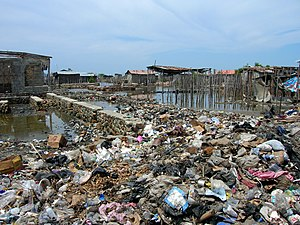 Environmental issues in Haiti - Household rubbish used to build a causeway in Cap-Haïtien.