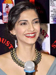 A shot of Sonam Kapoor, laughing away from the camera