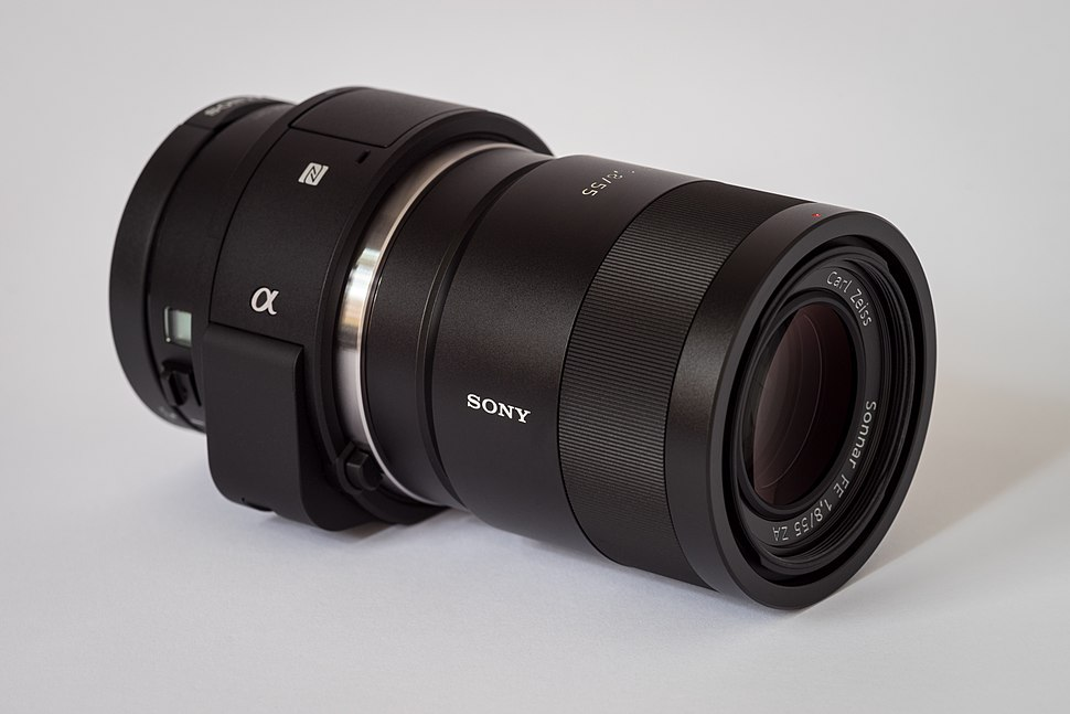 Sony Alpha ILCE-QX1 APS-C-frame camera with lens.jpeg