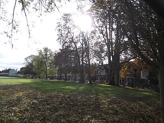 Bainton Road - View across the northwest corner of St John's College playing field to the south part of Bainton Road.