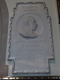 stone plaque showing George V in right profile